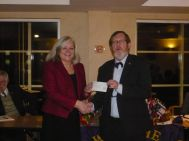 presenting the cheque to Brookfields head teacher